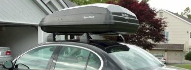The SportRack Aero XL roof box on a car